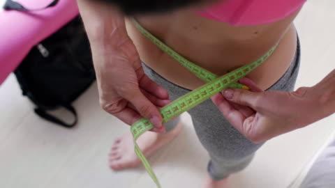 measuring belly/ chorzow/ poland - ほっそりした点の映像素材/bロール