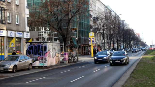 measuring stations in berlin in the frankfurter allee 86b in berlin for the measurement for example of nitrogen dioxide according to the current... - bicycle parking station stock videos and b-roll footage