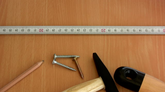 measuring - tape measure stock videos and b-roll footage
