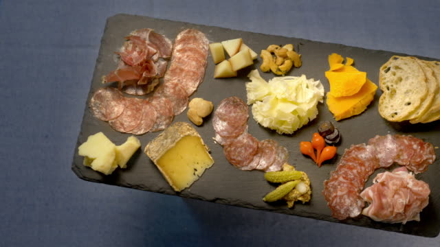 meat and cheese tapas platter appetizer - pan across. - tray stock videos & royalty-free footage