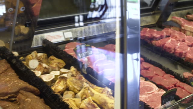 Meat and seafood products in a display case of a butcher shop