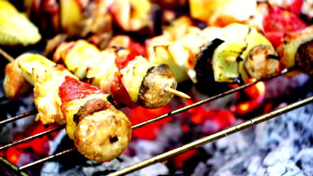 Meat and vegetables on a grill.