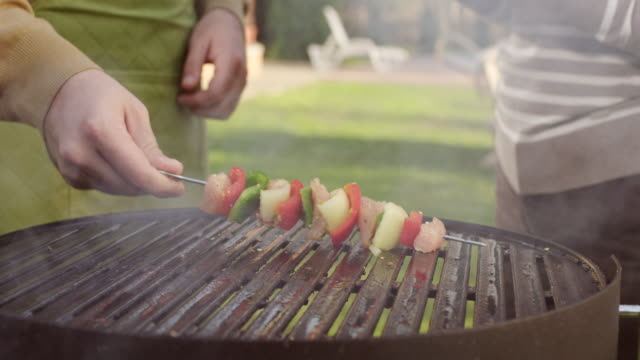 Meat and vegetables on a grill
