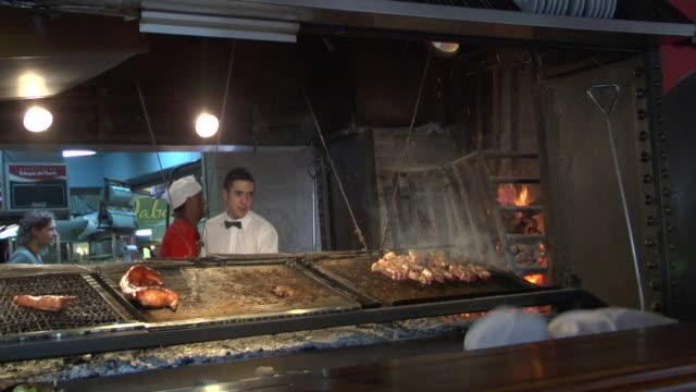 MS Meat being grilled in restaurant kitchen, Montevideo, Uruguay