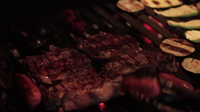 meat cooked in a argentinian barbecue asado - argentinian culture stock videos & royalty-free footage