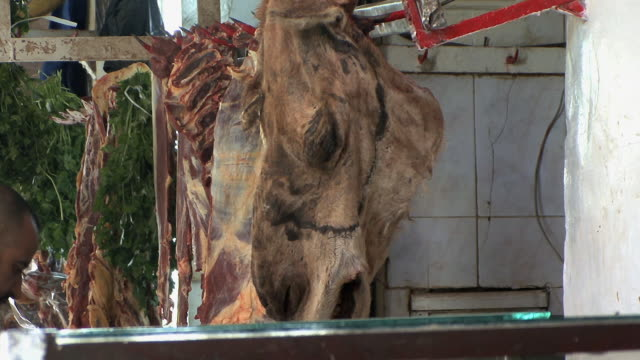 ms td meat hanging on butcher's hook, fez, morocco - one mid adult man only stock videos & royalty-free footage