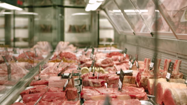meat in a butcher's shop - retail occupation stock videos & royalty-free footage