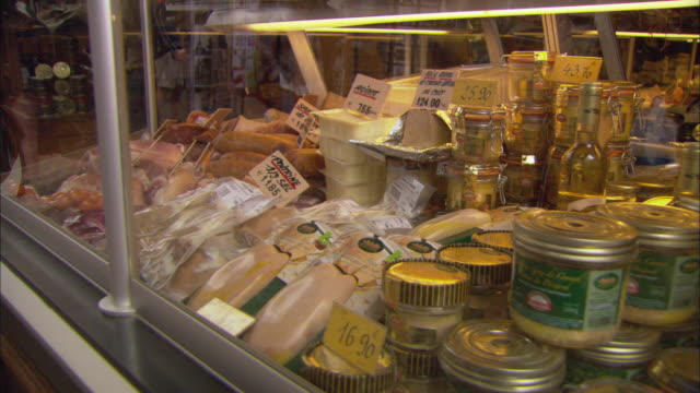 cu meat in display cabinet at butcher shop / paris, france - display cabinet stock videos & royalty-free footage