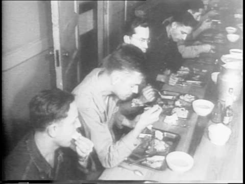 meat rationing is approved in united states / images of man using gas rationing coupon / rows of sides of beef hanging / washington dc / montage of... - anno 1942 video stock e b–roll