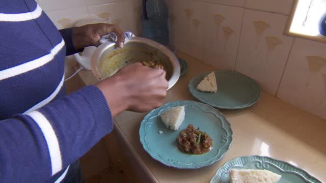 meat stew being cooked and served in home in kenya - preparing food stock videos & royalty-free footage