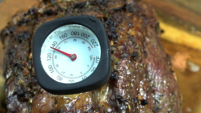 meat thermometer in a prime rib at 140 degrees. - thermometer stock videos & royalty-free footage