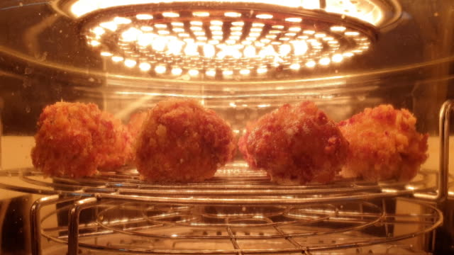 meatball, baked with heat, in heat pot. - meatballs stock videos & royalty-free footage