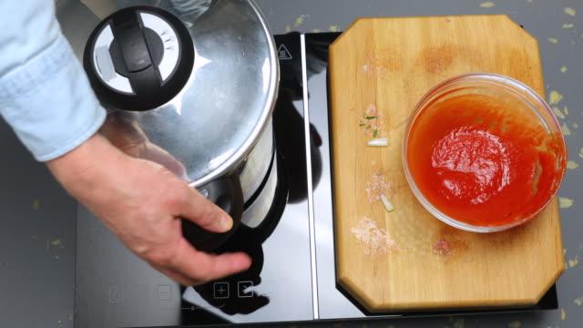 Meatballs and tomato sauce in pressure cooker.