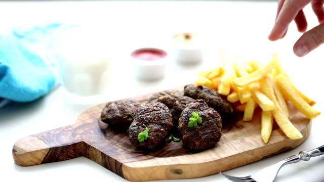meatballs, chips and coke - meatballs stock videos & royalty-free footage
