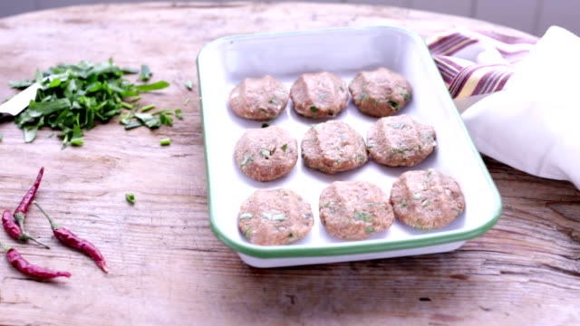 meatballs ready to be cooked - meatballs stock videos & royalty-free footage