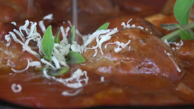 meatballs with parmigiano reggiano in marinara sauce - parmesan stock videos & royalty-free footage