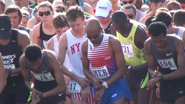 meb keflezighi america's top marathon runners competes in shelter island 10k start shot pull back from meb on jersey - salmini stock videos and b-roll footage