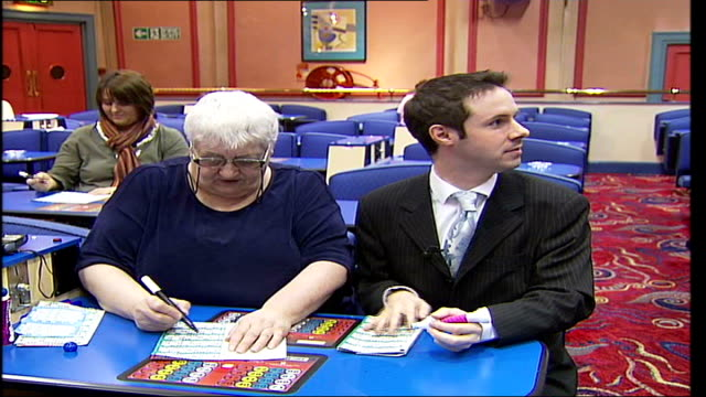 mecca bingo hall in islington faces closure because of financial difficulties; england: london: islington: mecca bingo hall: int woman smoking and... - hand of cards stock videos & royalty-free footage