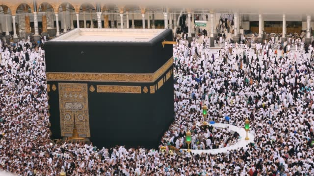 mecca muslim pilgrims touring the holy kaaba in mecca in saudi arabia - congregation stock videos & royalty-free footage