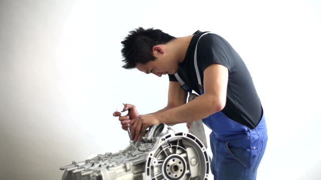 mechanic behind an engine is working with a wrench - wrench stock videos & royalty-free footage