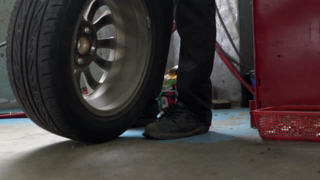 Mechanic Changing The Tire
