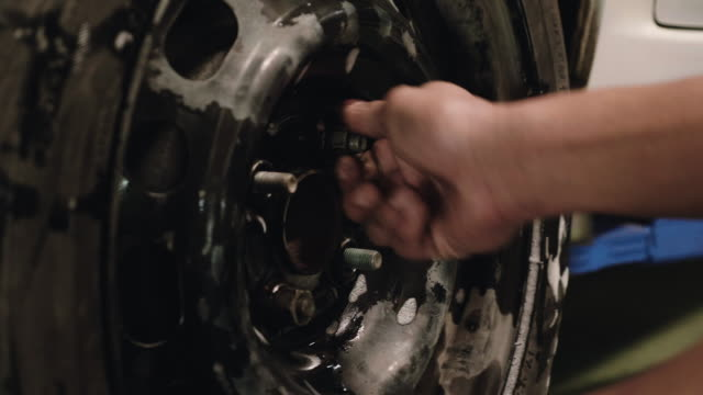 mechanic changing the tire - fetish wear stock videos and b-roll footage
