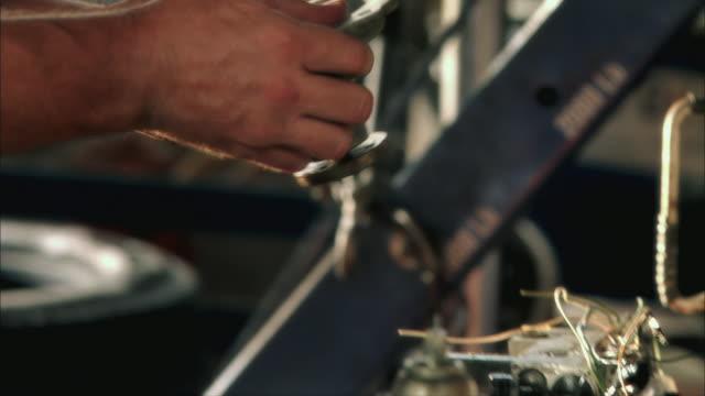 CU TU Mechanic cleaning car part / Tampa, Florida, USA