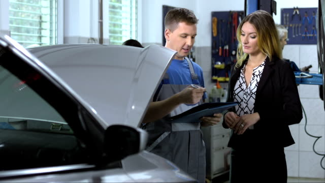 mechanic explaining repairs for car repair - repair garage stock videos & royalty-free footage