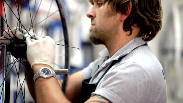 Mechanic fixes bike wheels close up