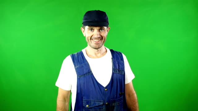 Mechanic / Handyman smiling in front of Green Screen