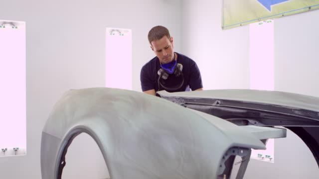 MS PAN Mechanic preparing car being restored for body work
