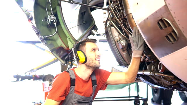 mechanic repairing aircraft - machine part stock videos & royalty-free footage
