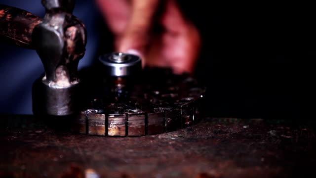 Mechanic repairing ceiling fan motor