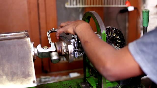 mechanic repairing ceiling fan motor - stereotypical stock videos & royalty-free footage