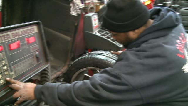 mechanic repairing tires in auto shop on february 24, 2014 in chicago, illinois. - puncture repair kit stock videos & royalty-free footage