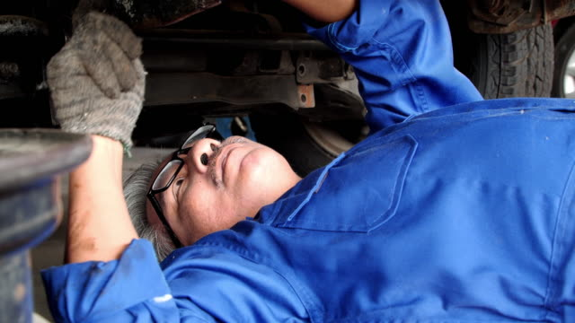 mechanic senior man working at workshop car service, repair, maintenance and people concept - car mechanic stock videos & royalty-free footage