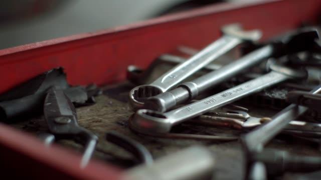 mechanic tool in car repair shop. - macro stock videos & royalty-free footage