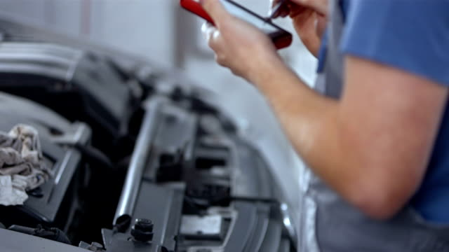 mechanic using a diagnostic tool - electronic organizer stock videos and b-roll footage
