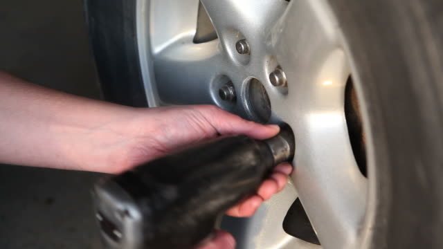 Mechanic Using Impact Wrench to Install Wheel Lug Nuts