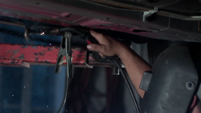 MS SLO MO Mechanic welding metal on automobile / Bergenfield, , New Jersey, USA