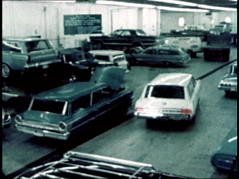 1967 montage mechanic working on car in service center /  - automobile industry stock videos & royalty-free footage