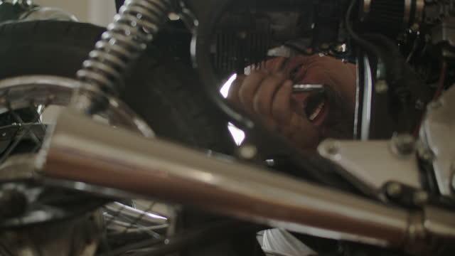 cu mechanic working on motorcycles - repair shop stock videos & royalty-free footage