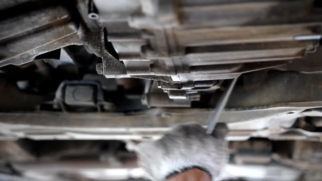 Mechanic Working Under Car; HD: Photo JPEG
