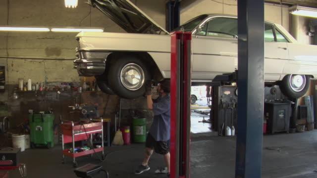 WS Mechanic working underneath car / Los Angeles, California, USA