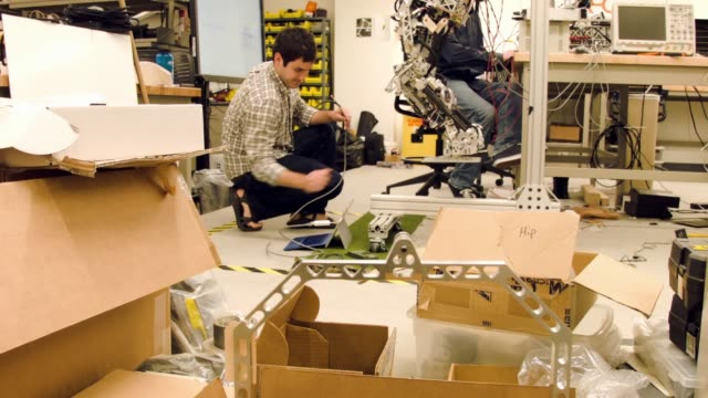 Mechanical and electrical engineering students from Team Valor build and test the ESCHER they are building for the Defense Advanced Research Projects...