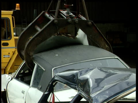 mechanical claw picks up scrap car in scrapyard - claw stock videos and b-roll footage
