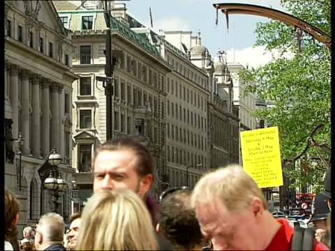 mechanical girl and sultan's elephant walk streets of london; work men in yellow vests moving in on barrel with crane and moving platform /... - customised stock videos & royalty-free footage