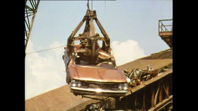 mechanical grabber picks up rusty car in scrapyard; 1972 - decline stock videos & royalty-free footage