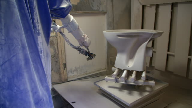 mechanical robotic arm paints toilet in a factory - beige stock videos & royalty-free footage