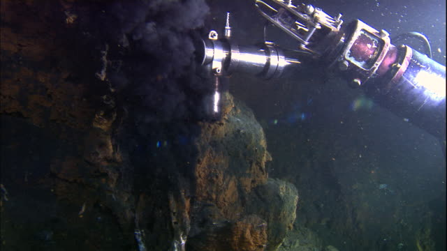 mechanical submersible arm samples black smoker deep sea vent, mid atlantic ridge, atlantic ocean - seabed stock videos & royalty-free footage